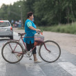 Senior woman crossing a road with bicycle, Russia — Stock Photo