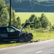 Stock Photo: Crashed car by road, Russia
