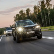 Suv cars on a road — Stock Photo