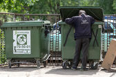 Poor man searching in garbage, Vologda, Russia — Stock Photo