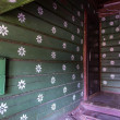 Traditional russian wooden house decorated with painted flowers — Stock Photo #26951329