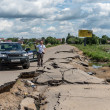 Suv  car on a broken russian road — Stockfoto