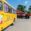 Schoolbus and fire truck in Yaroslavl, Russia — Stock Photo