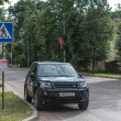 Stock Photo: Suv car on street of russitown