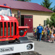 Group of kids on excursion at firefighter department in Yaroslavl town, Russia — Stock Photo #26952159