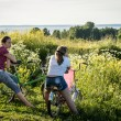 Stock Photo: Two teenage Girls with bicycles on meadow, Russia