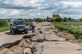 Suv car on a broken russian road — Stock Photo