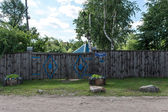 Wodden fence in Russian village — Stock Photo