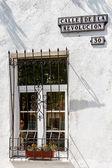 Calle della Revolucion. Street sign from Cuba on a building in Yaroslavl, Russia — Stock Photo