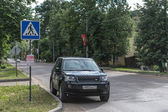 Suv car on a street of russian town — Stock Photo