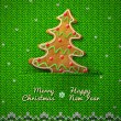 Christmas tree cookie on knitted background — Stock Vector #34758891