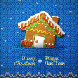 Christmas house cookie on knitted background — Stock Vector #35903711