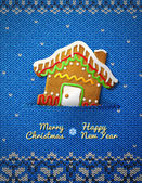 Christmas house cookie on knitted background — Stock Vector