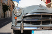 Old car in old city — Stock Photo