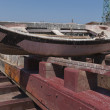 Stock Photo: Old fishing boat being repaired at small shipyard