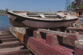 Old fishing boat being repaired at a small shipyard — Stock Photo