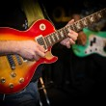Guitar and guitarist — Stock Photo