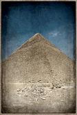 Grunge image of Desert and pyramid — Photo