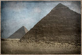 Grunge image of Desert and pyramid — Stock Photo