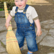 The boy with a broom - Stock Photo