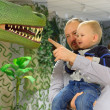 Dinosaur and boy — Stock Photo