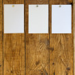 Stickers on the wooden wall — Stock Photo #34191481