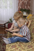 Sister and brother with tablet — Stock Photo