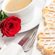 Romantic table setting with a single red rose - Stock Photo