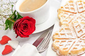 Romantic table setting with a single red rose — Stock Photo