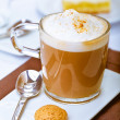 Frothy mug of aromatic cappuccino — Stock Photo