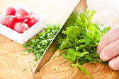 Chopping fresh parsley — Stock Photo