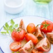 Three varieties of tomato on a plate — Stock Photo