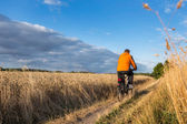 Man riding a bicycle on a cycling tour of Bornholm — Stock Photo