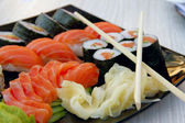 Sushi rolls with vassabi on the plate — Stock Photo