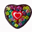 Stock Photo: Decorative basket as heart with colored glass and a red heart.