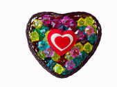 Decorative basket as heart with colored glass and a red heart. — Stock Photo