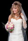 Happy beautiful bride on black background with bouquet of weddin — Stock Photo