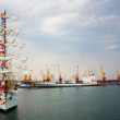 Stock Photo: Sailing ship and a cargo ship docked in the port