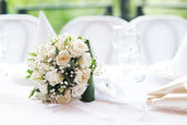 Wedding bouquet on a table — Stock Photo