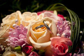 Wedding rings in a wedding bouquet — Stock Photo