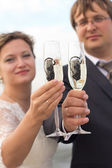 Newlyweds with glass of champagne close up — Stock Photo