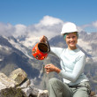 Woman hiker smile, sit on mountain rock with kettle — Stock Photo
