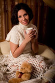 Girl in the home with a cup of tea — Stock Photo