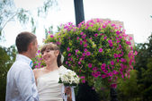 Cute newlywed couple laughing together — Stock Photo