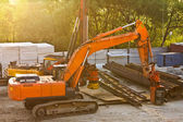 Modern orange excavator machines — Foto de Stock