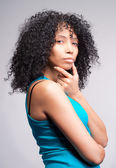 Mulatto woman thinking — Stock Photo