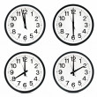 Group of wall clocks — Stock Photo