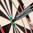 Dart in bullseye on the target — Stock Photo