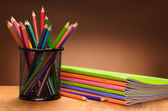 Set of pencils and notebooks — Stock Photo