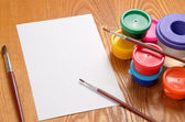 Blank sheet of paper and drawing accessories — Stock Photo